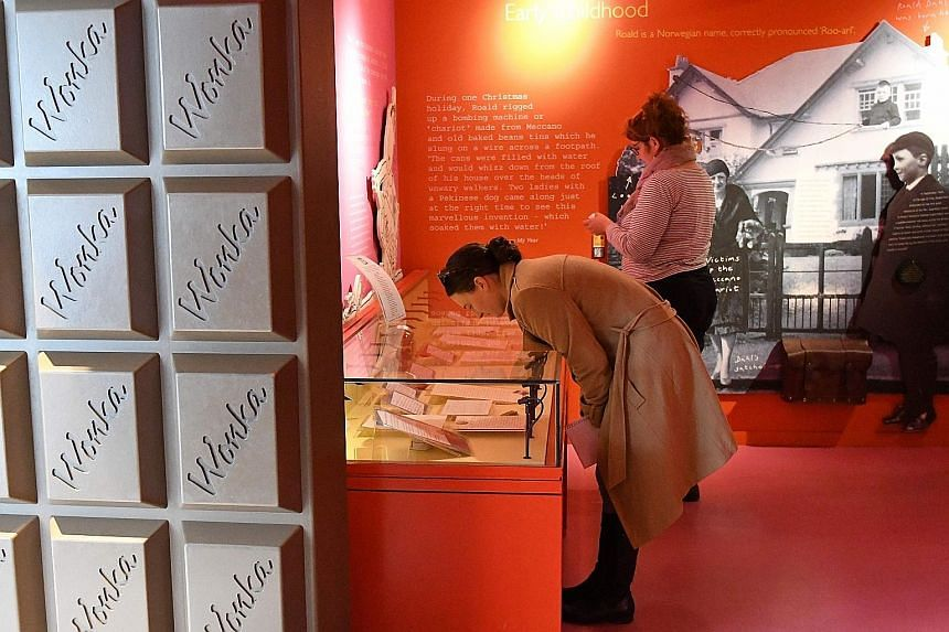 Matilda faces down United States President Donald Trump (left) in the courtyard of the museum that also features photos of Roald Dahl (above) and a re-creation of his writing hut (right), down to the pencil shavings. At the entrance, visitors walk th