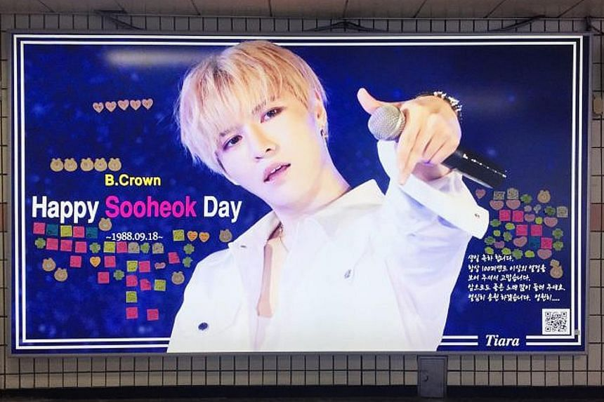A birthday advertisement dedicated to K-pop celebrity Sooheok at Apgujeong station in Seoul.