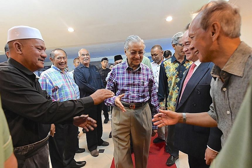 Malaysian Prime Minister Mahathir Mohamad (centre) attended a dialogue with taxi drivers on Langkawi island yesterday. Some drivers disagreed with the Premier's views on ride-hailing service Grab.