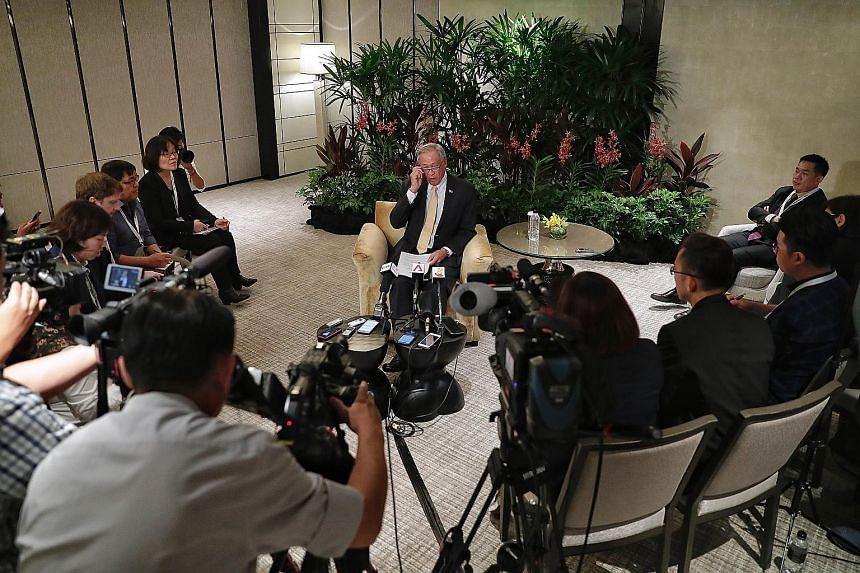 Defence Minister Ng Eng Hen speaking to the media after the ADMM-Plus on Saturday at Shangri-La Hotel. He acknowledged that even getting the 10 Asean nations on board for the multilateral air code was not a given.