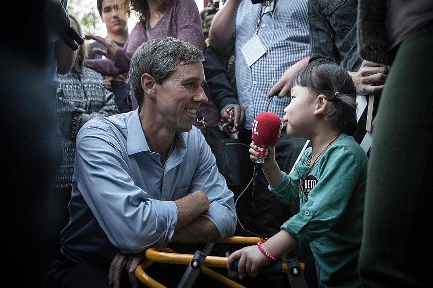 Democratic Senate candidate Beto O'Rourke being interviewed by a young supporter after a campaign rally in Dallas, Texas, last Saturday. Democrats are hoping that Mr O'Rourke might be able to knock Republican Ted Cruz off his Senate seat.