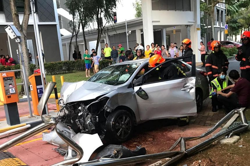 Readers of citizen journalism website Stomp sent photos showing a mangled silver car with severe damage to its front bumper at the carpark.