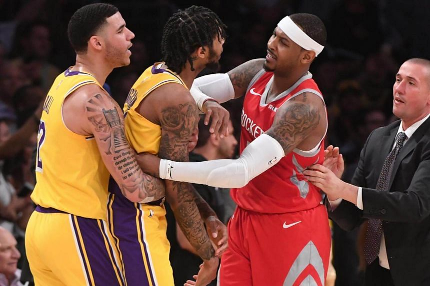 Los Angeles Lakers guard Lonzo Ball (#2) and Houston Rockets forward Carmelo Anthony restrain Los Angeles Lakers forward Brandon Ingram (#14) after a fight in the fourth quarter of the game.