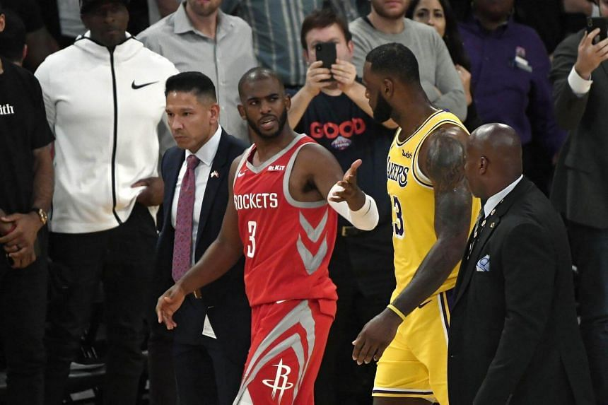 Chris Paul of the Houston Rockets speaks with LeBron James of the Los Angeles Lakers after he was ejected for fighting during the second half of the game.
