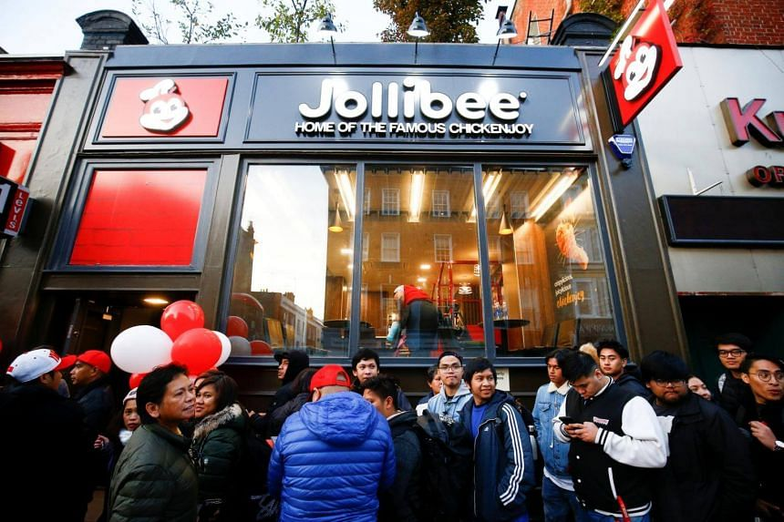 People queue ahead of the opening of the first Jollibee restaurant in London, on Oct 20, 2018.