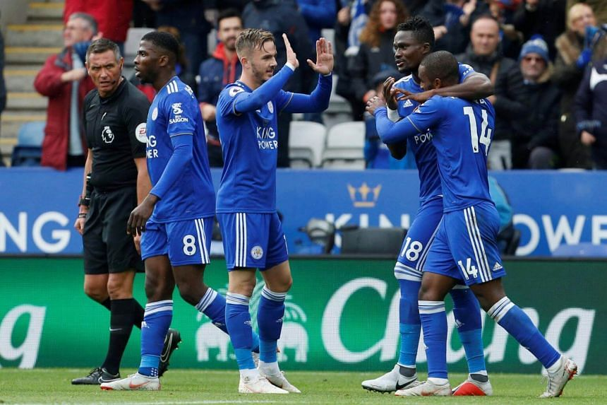 Leicester City's Portuguese defender Ricardo Pereira (right) celebrates scoring his team's first goal during the English Premier League football match between Leicester City and Everton, on Oct 6, 2018.