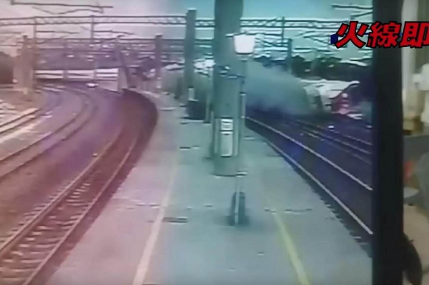 All eight cars of the express train ran off the tracks on a bend near the Xinma Station in Yilan county, Taiwan, at 4.50pm on Oct 21, 2018.