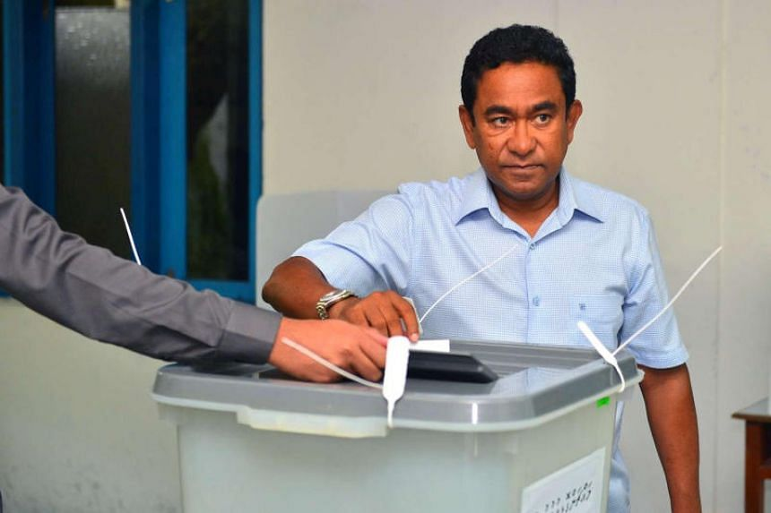 Maldives President Abdulla Yameen casts his vote at a polling station during the presidential election in Male, Maldives, on Sept 23, 2018.