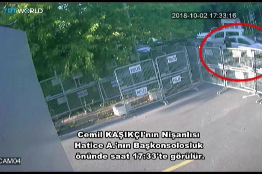 A frame grab from a police CCTV video allegedly shows Ms Hatice Cengiz (circled), fiancee of Saudi journalist Jamal Khashoggi, waiting outside the Saudi consulate in Istanbul, Turkey, on Oct 2, 2018.