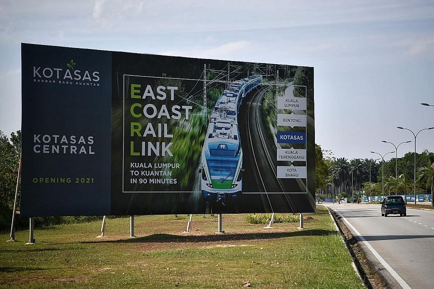 A billboard in Kuantan highlighting the East Coast Rail Link. The Malaysian government is in discussions on whether to scrap the project.