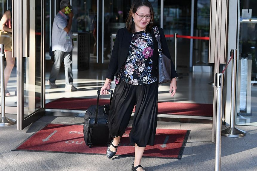 Workers' Party chairman Sylvia Lim leaving the Supreme Court yesterday. Ms Lim and Senior Counsel Davinder Singh were engaged in a 35-minute tussle on the stand, during which Mr Singh tried to get her to agree that the WP MPs, including former party
