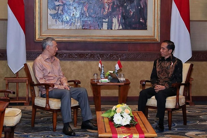 Prime Minister Lee Hsien Loong meeting Indonesian President Joko Widodo at a retreat in Bali earlier this month.