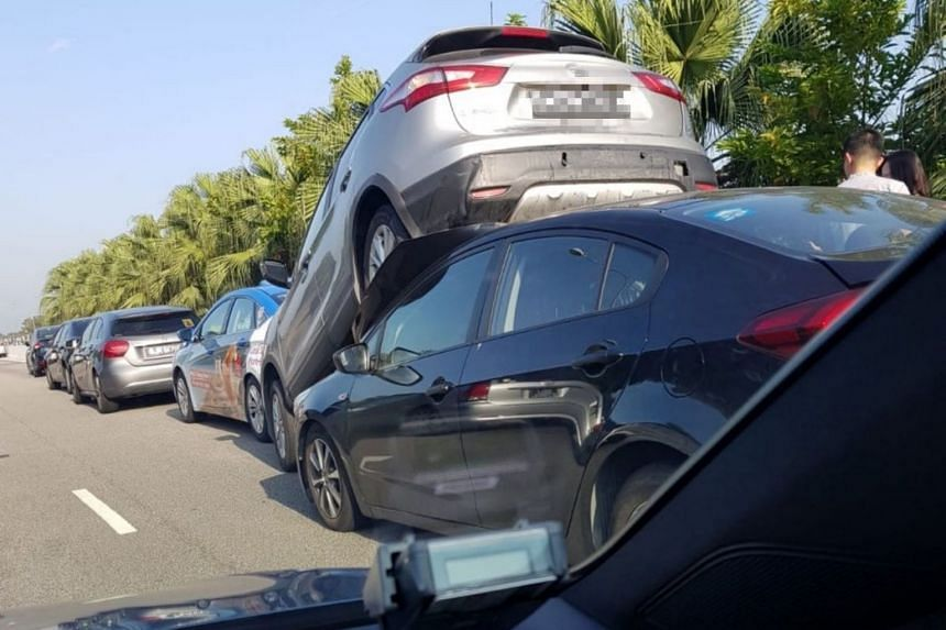 Five vehicles were involved in one of the chain collisions, which saw a silver car being lifted in the air from behind before landing on top of a black car.