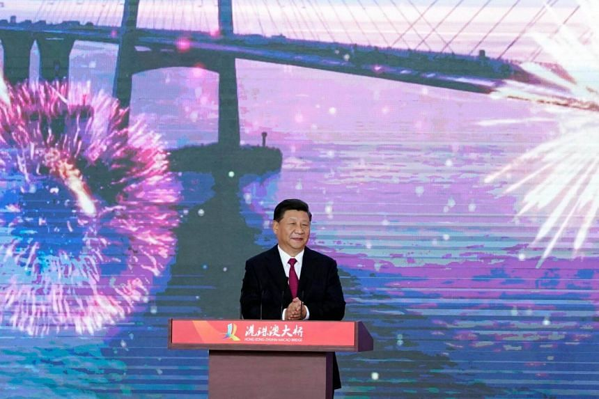 China's President Xi Jinping announced the bridge officially open at a ceremony also attended by Hong Kong's and Macau's city leaders at a new port terminal in the southern mainland city of Zhuhai.