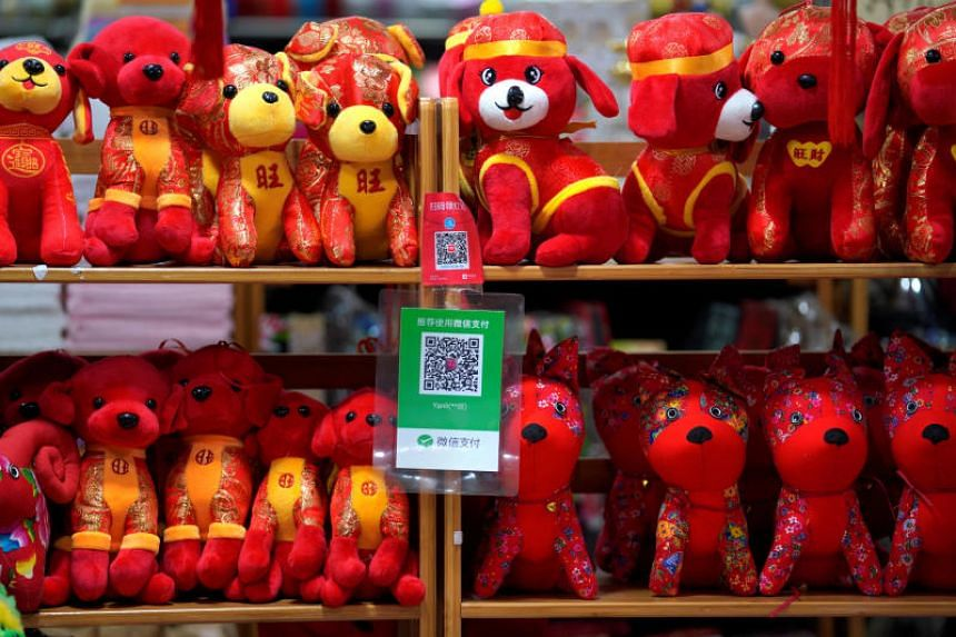 QR codes of Alipay (top) and Wechat Pay displayed at a toy shop in Beijing on Feb 8, 2018.