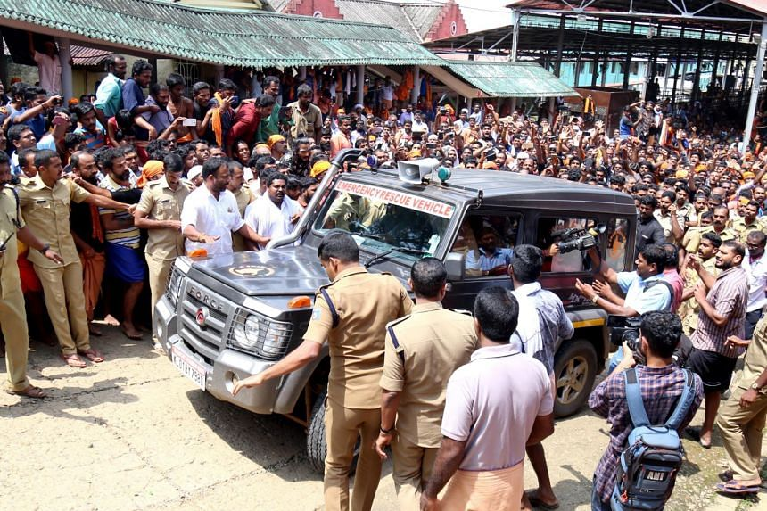 A police van, believed to be carrying a woman, surrounded by protesters near the Sabarimala temple at Pamba, Kerala, on Oct 21, 2018.