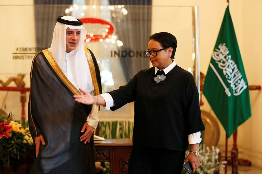 Indonesian Foreign Minister Retno Marsudi welcomes her Saudi counterpart Adel al-Jubeir before their meeting in Jakarta on Oct 23, 2018.