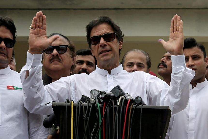 Imran Khan, chairman of Pakistan Tehreek-e-Insaf, speaks after voting in the general election in Islamabad, on July 25, 2018.