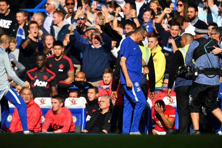 Chelsea assistant coach Marco Ianni celebrates their second goal in front of the Manchester United bench at Stamford Bridge, London, Britain, on Oct 20, 2018.