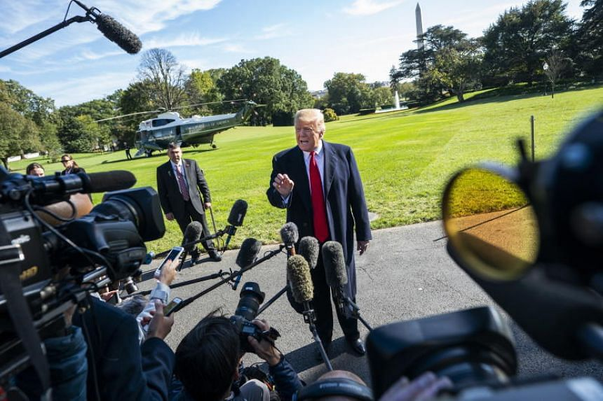 US President Donald Trump speaks to the media as he departs the White House for Houston, Texas, to support Senator Ted Cruz in a rally in Washington, DC, US, on Oct 22, 2018.