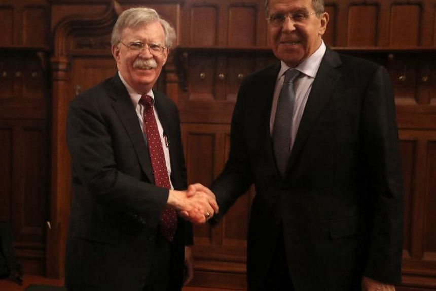 John Bolton (left), National Security Adviser to the US President, shaking hands with Russia's Foreign Minister Sergei Lavrov during their meeting on nuclear treaty in Moscow on Oct 22, 2018.