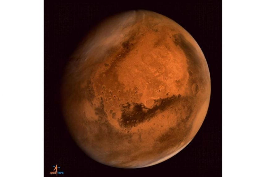 Mars is seen in an image taken by the Indian Space Research Organisation Mars Orbiter Mission spacecraft.