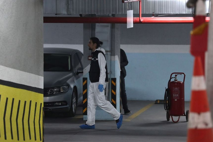 Forensic police officers arrive to search a diplomatic car belonging to the Saudi consulate.