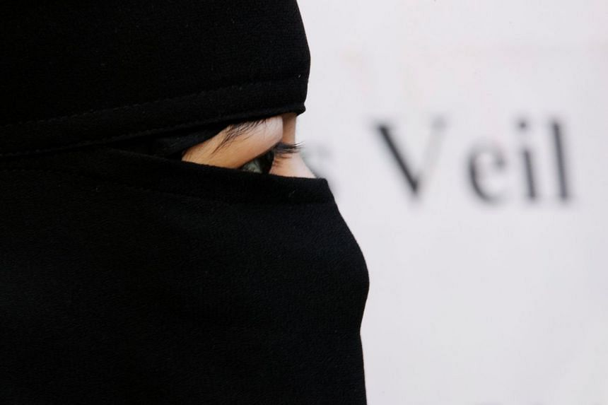 A Muslim woman taking part in a demonstration outside the French Embassy in London in 2010.