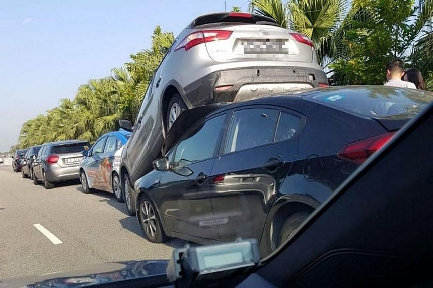 Five cars were involved in one of the two chain collisions on the Tampines Expressway yesterday during the morning peak hour. A silver car ended up being lifted in the air from behind before landing on top of a black car. No one was injured in that c
