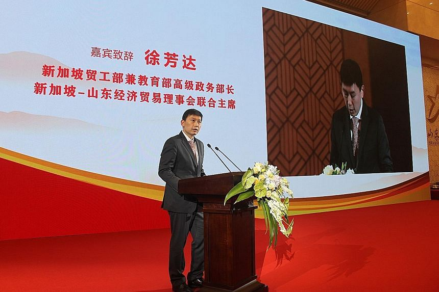Senior Minister of State for Trade and Industry and Education Chee Hong Tat delivering a speech at the 20th Singapore-Shandong Business Council meeting yesterday. He is on a four-day visit to Shandong with 60 officials and businessmen.