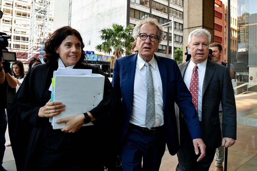 Australian actor Geoffrey Rush (centre) arrives at the Federal Court in Sydney, on Oct 23, 2018.