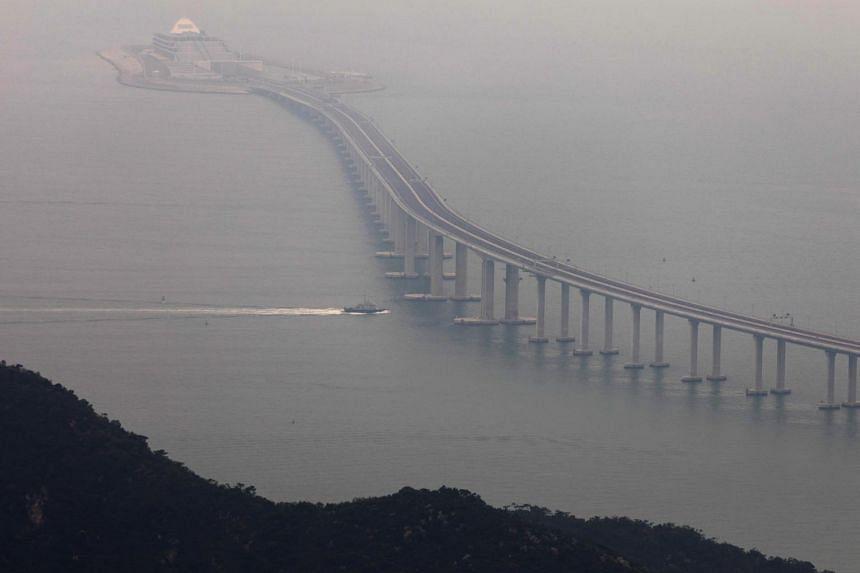 A police boat sails under the Hong Kong Link Road, part of the Hong Kong-Zhuhai-Macau bridge, on Oct 23, 2018.