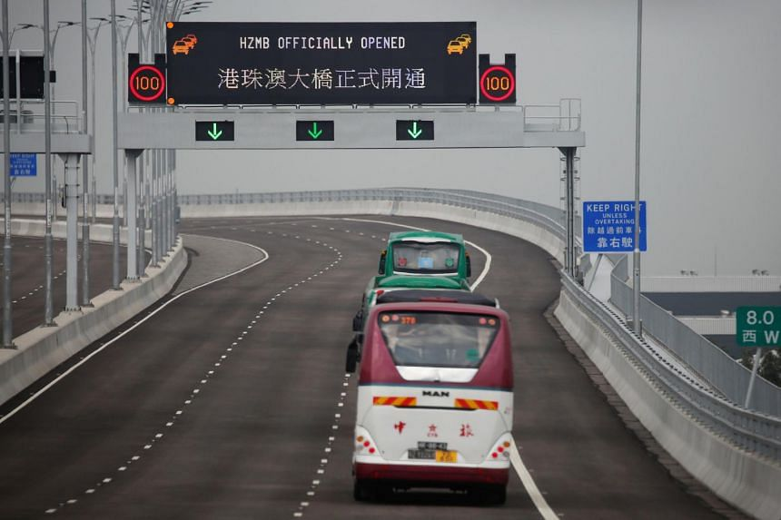 Buses on the Hong Kong-Zhuhai-Macau Bridge (HZMB) during its first day of operation on Oct 24, 2018. Two types of public transportation - shuttle bus and cross-boundary coach - run on the bridge