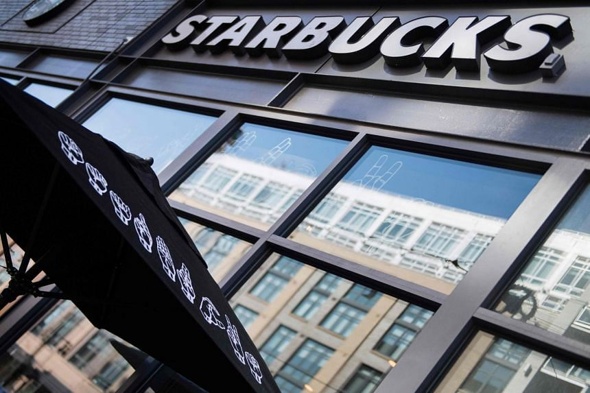 "Starbucks is written in sign language on an umbrella outside the first ""signing store"" in the US."