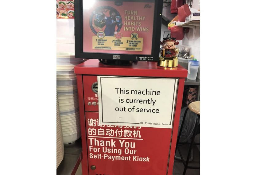 Many of the bright red self-payment machines at Ci Yuan have white pieces of paper plastered over them, informing customers that they are out of order.