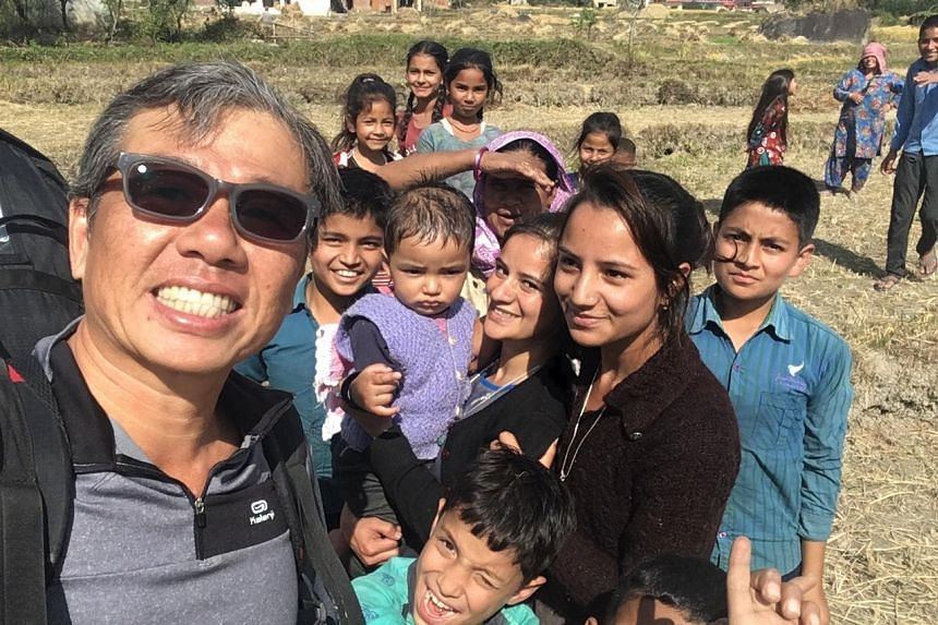 Mr Ng Kok Choong posing for a selfie with local children in Bir Billing after completing a flight last week.