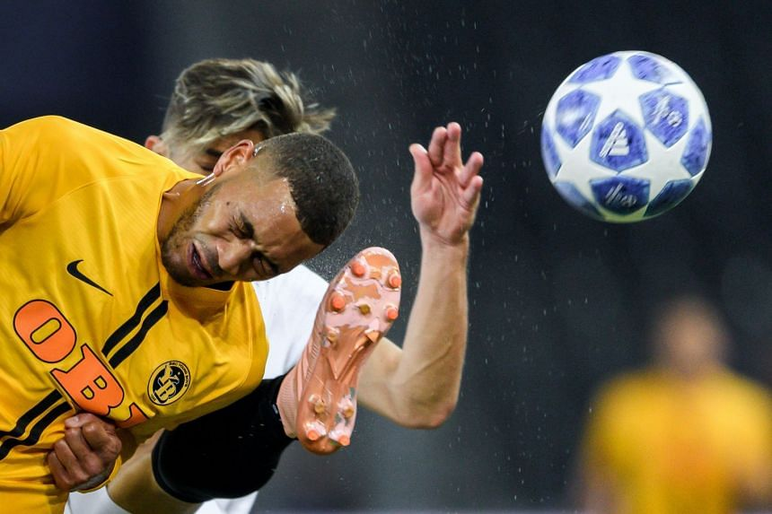 Young Boys' Guillaume Hoarau (in yellow) and Valencia's Gabriel Paulista vie for the ball.