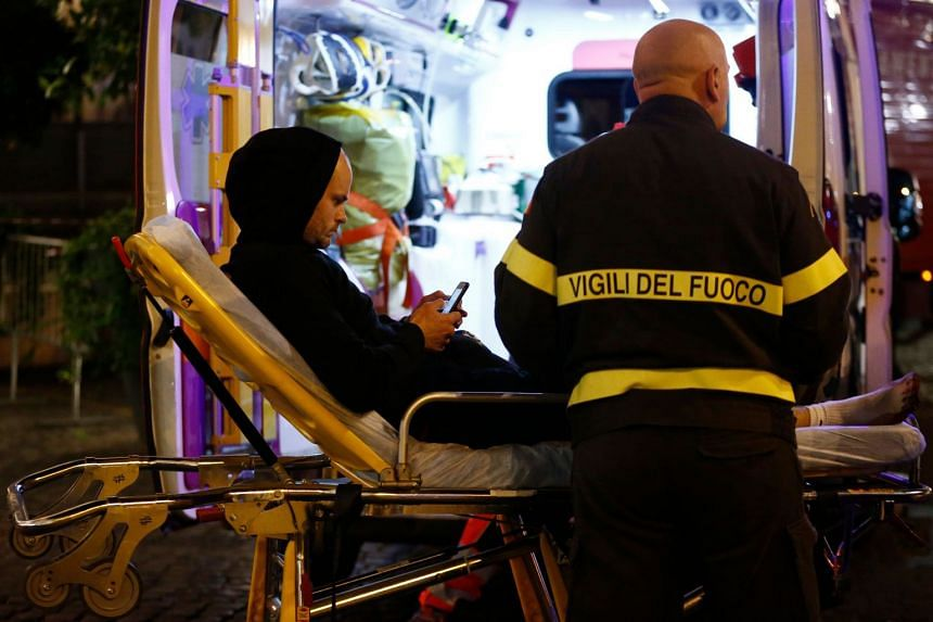 First responders evacuate wounded persons on Piazza della Repubblica in central Rome.