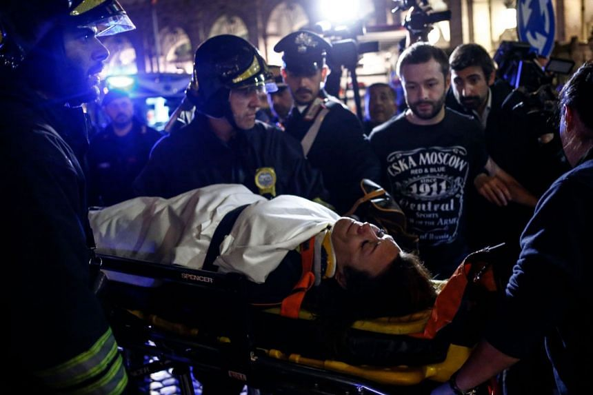 First responders evacuate a wounded person from Piazza della Repubblica in central Rome.