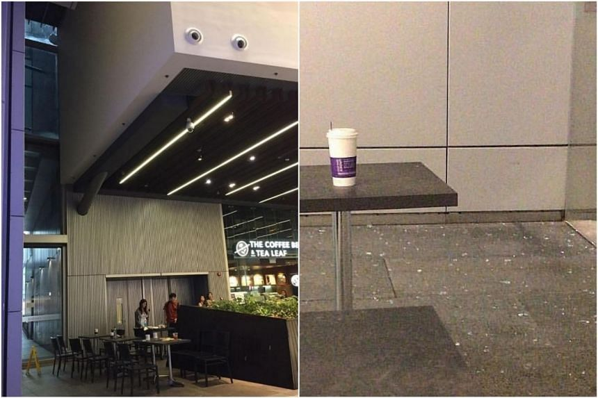 Part of the glass panel (top left) above the entrance next to The Coffee Bean and Tea Leaf outlet at Orchard Central shattered, causing glass to fall onto patrons sitting nearby.