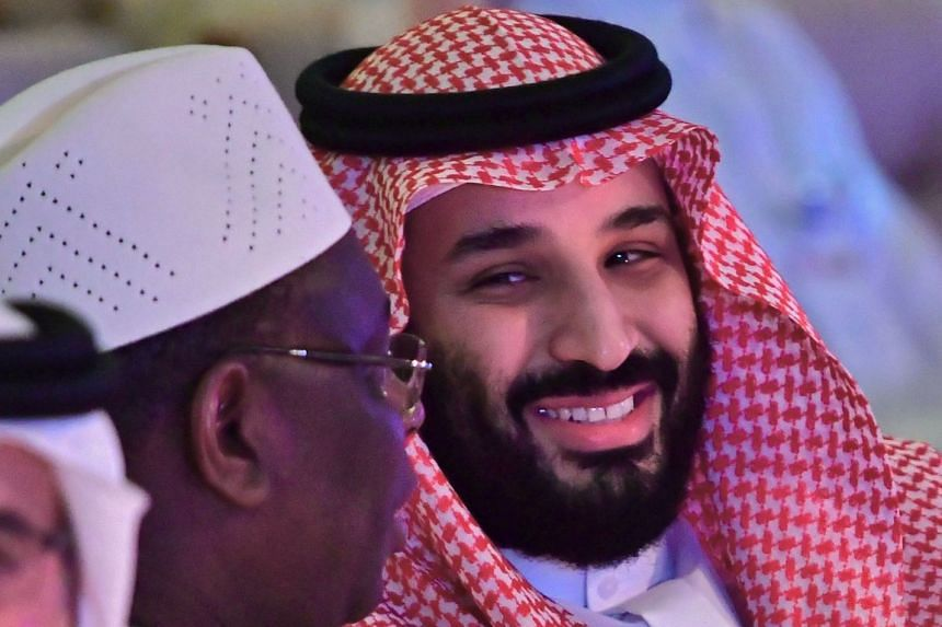 Crown Prince Mohammed bin Salman (right) talking to Senegal President Macky Sall during the FII Forum.