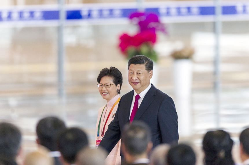 Chinese President Xi Jinping and Hong Kong Chief Executive Carrie Lam at the opening ceremony of the new bridge yesterday. The new 55km crossing costs S$27.6 billion and joins two former European colonies to the Pearl River Delta in Guangdong to form