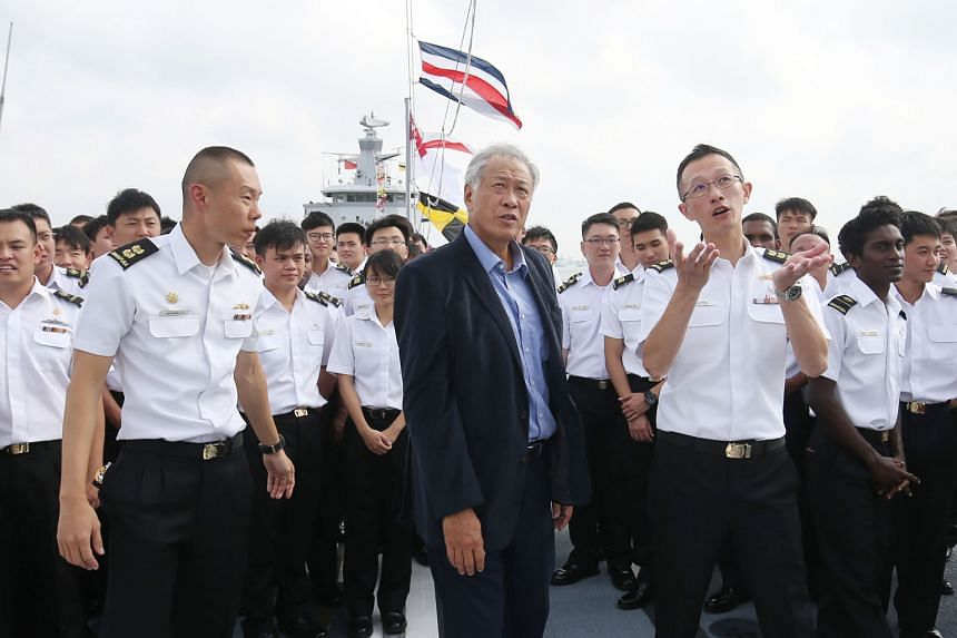 Defence Minister Ng Eng Hen with Lieutenant-Colonel Aaron Li Jun Hong (extreme left) and Colonel Lim Yu Chuan on board the RSS Stalwart yesterday.