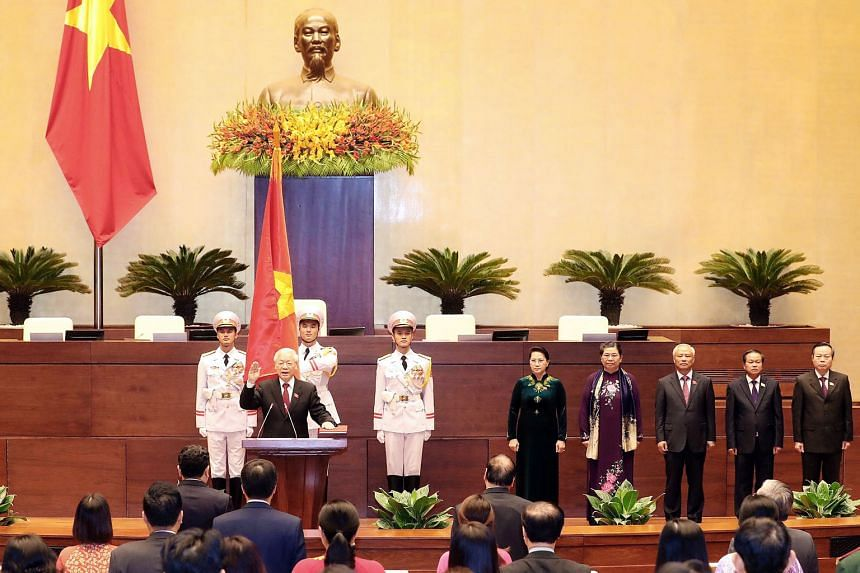 """Vietnamese Communist Party general secretary Nguyen Phu Trong taking the oath of office after being elected as President of Vietnam in Hanoi yesterday. The 74-year-old asked for sympathy from the nation, citing his """"worrisome"""" old age and health in h"""