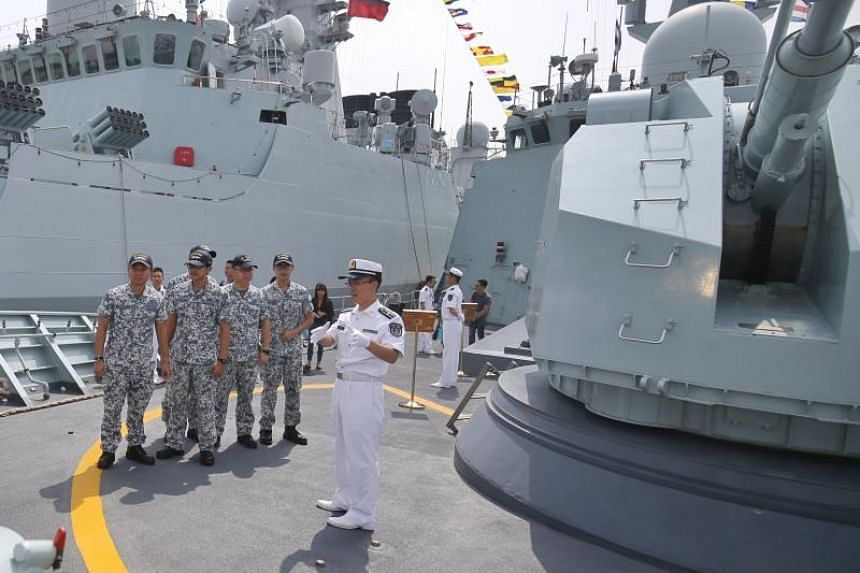 Crew from the Republic of Singapore Navy frigate RSS Stalwart being given a tour on board the Chinese frigate Huangshan on the third day of the Asean-China Maritime Field Training Exercise.