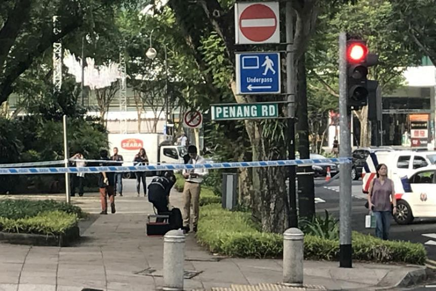 Police investigating a suspicious item in a cordoned off a section of the park at the junction of Penang Road and Penang Lane on Nov 3, 2017.