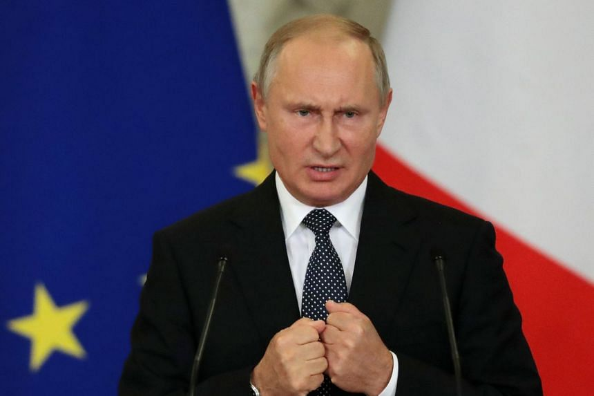 Putin speaking during a joint news conference with Italian Prime Minister Giuseppe Conte in Moscow, Oct 24, 2018.