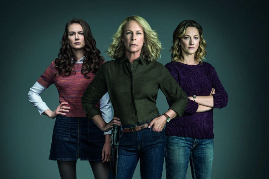 Jamie Lee Curtis (centre) takes on masked killer Michael Myers in Halloween with Andi Matichak (left) and Judy Greer (right), who play her granddaughter and daughter.