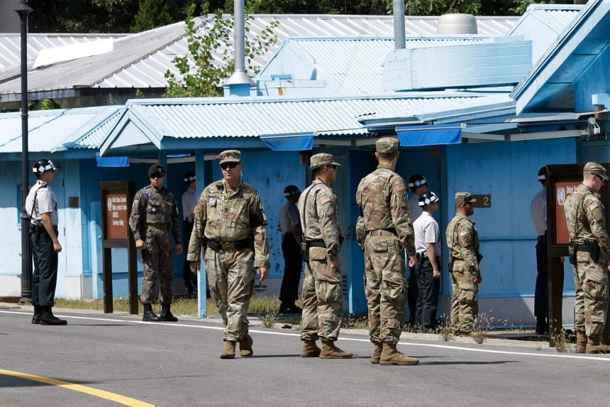 South Korean and US Army soldiers standing guard at the border village of Panmunjom in the Demilitarized Zone, on Sept 7, 2018.