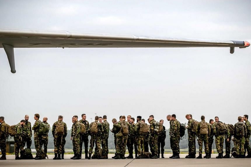 Dutch soldiers depart from Eindhoven Airport to participate in the Nato exercise Trident Juncture, which will take place in Norway from Oct 25 October to Nov 23, 2018.